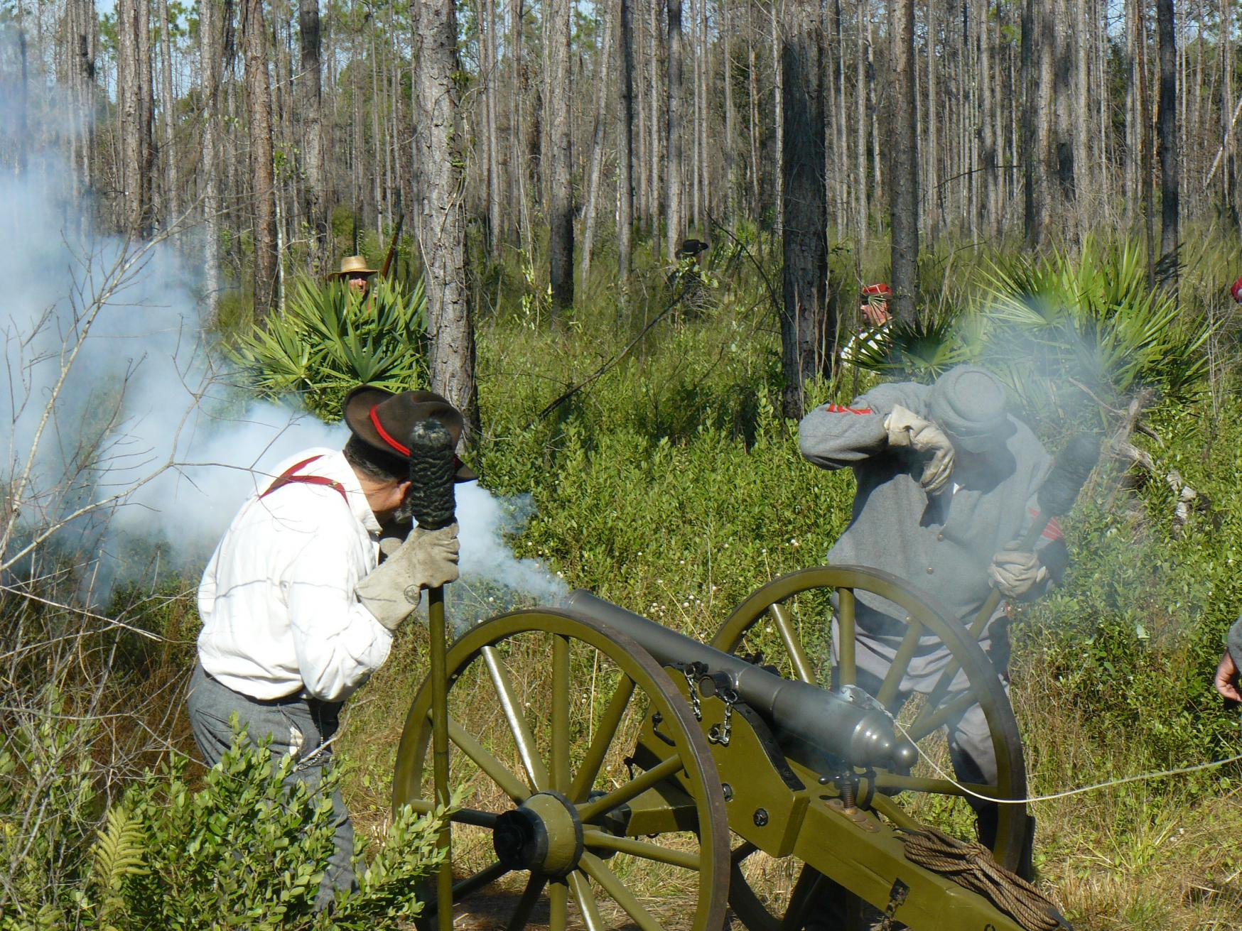 Confederate men firing Cannon to kill them Yankees at the agriculture Museum  Re-enactment.